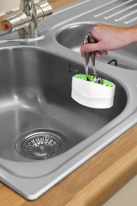 A sink mounted scrubber for faster and more thorough hand washing.