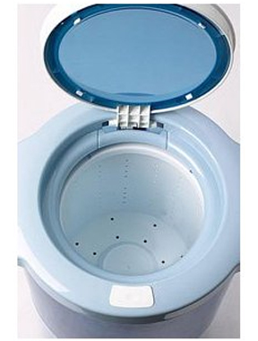 As drum spins at high speeds, water is forced outward through the holes.