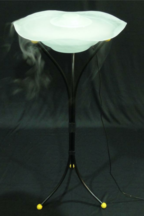 Tall black metal stand supports a large glass bowl.