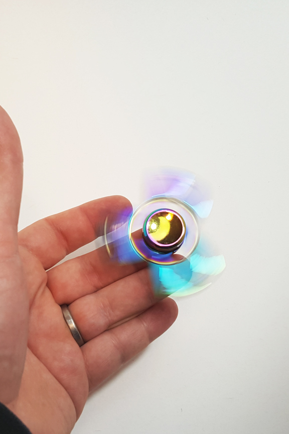 Rainbow alloy fidget spinner in action.