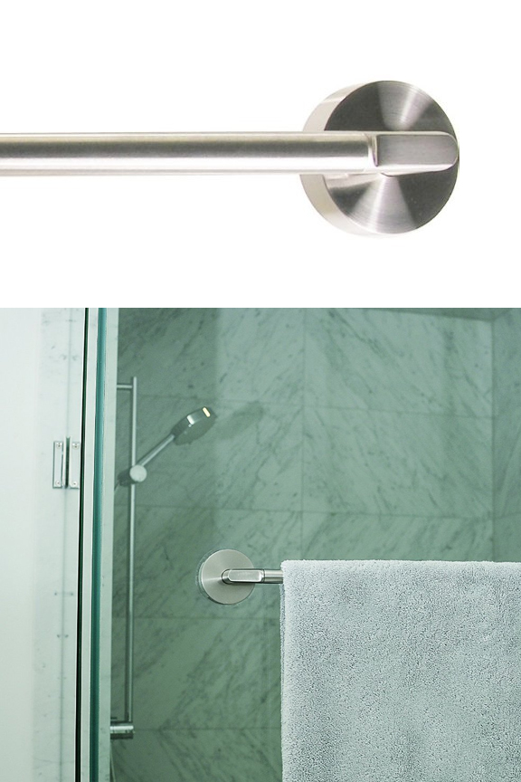 Close up view. Towel bar attaches flush to the wall.