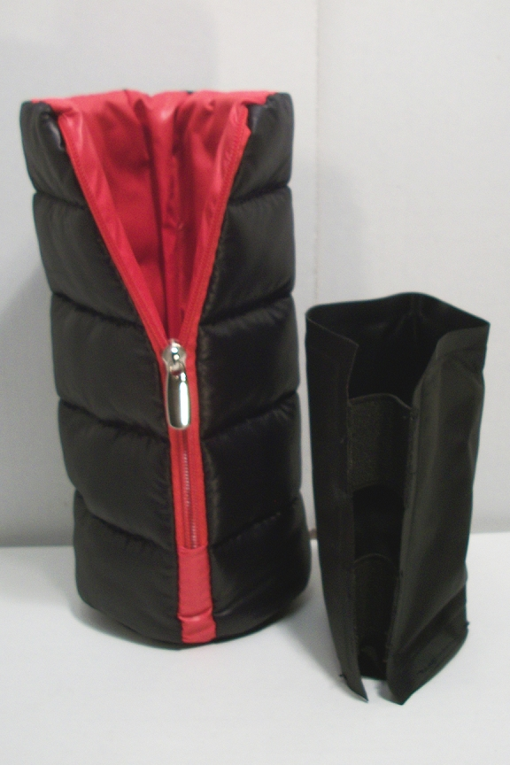 Puffy zippered exterior with freezable inside that's removable.